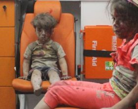 a child sits in an ambulance apparently after being pulled out of a building hit by an airstrike. Photograph: Aleppo Media Centre