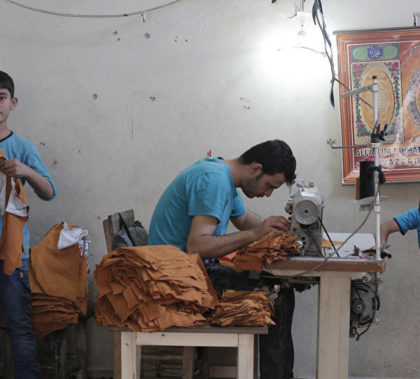 Syrian refugees, including children, work at a clothing workshop in Gaziantep, south-eastern Turkey.