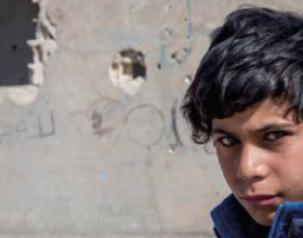 Ahmed, 12, now lives in an abandoned petrol station with 14 members of his family, having fled the violence in his hometown three months ago. Photo Credit: Save The Children