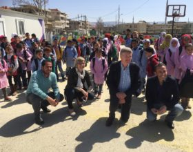 Al-Fanar Media staff, David Wheeler and Ursula Oaks, join the principal and field coordinator at a MAPS school.