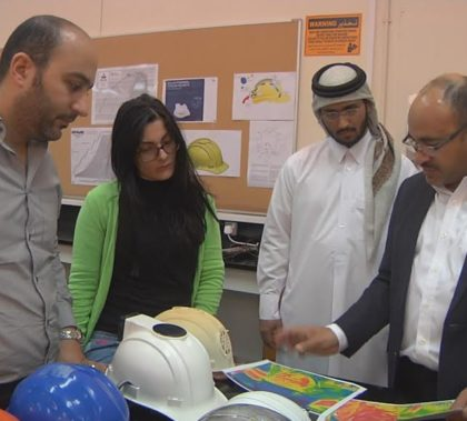 Professor at the College of Engineering at Qatar University Dr. Saud Abdul-Aziz Abdul-Ghani talking with team members. Photo: Eman Kamel